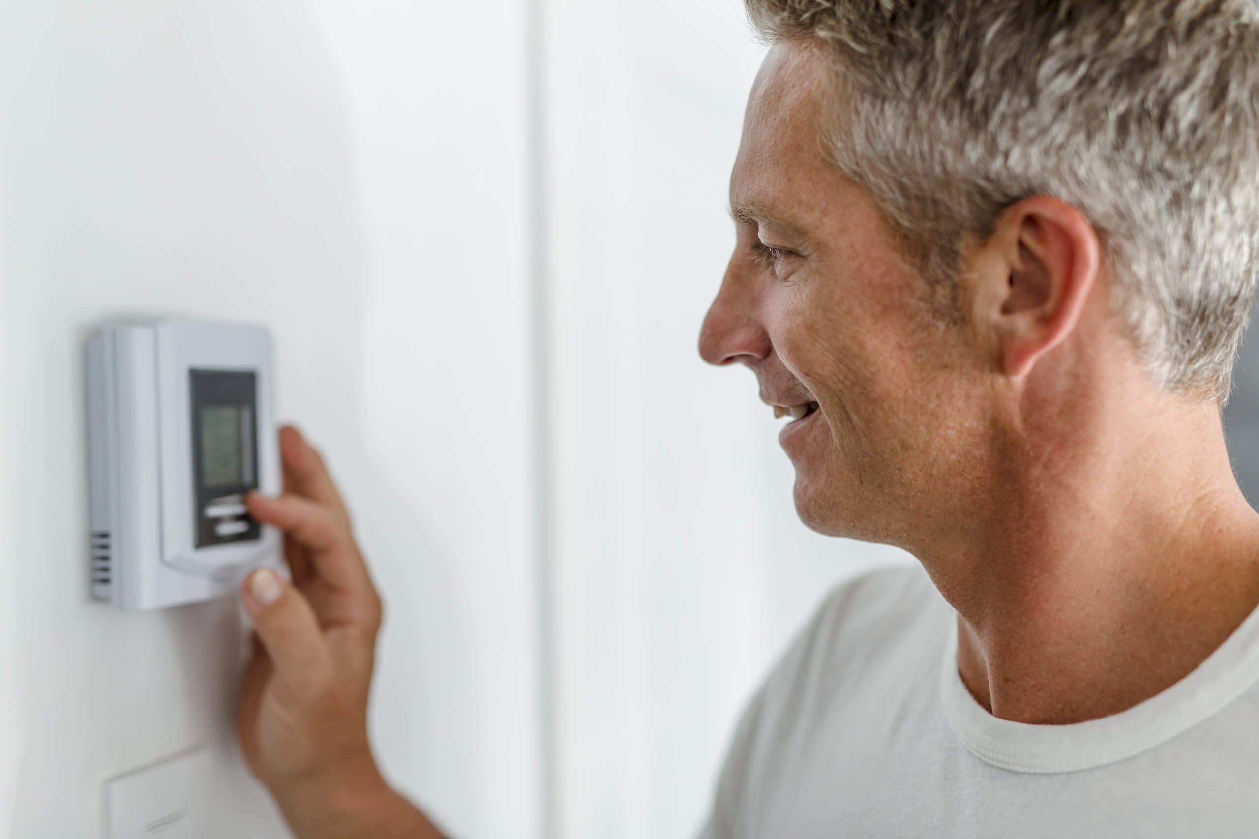 Adjusting a programmable thermostat